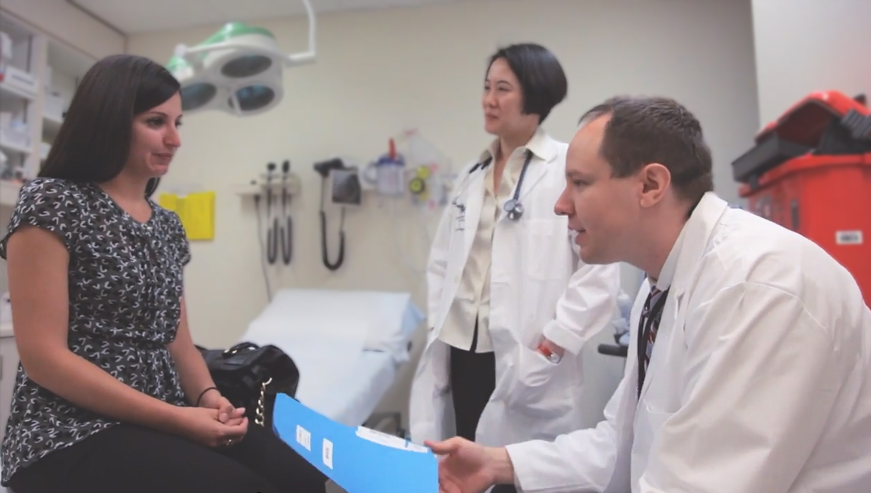 Dr. Siu and Dr. Bedard meet with a patient to discuss the studies she is eligible for